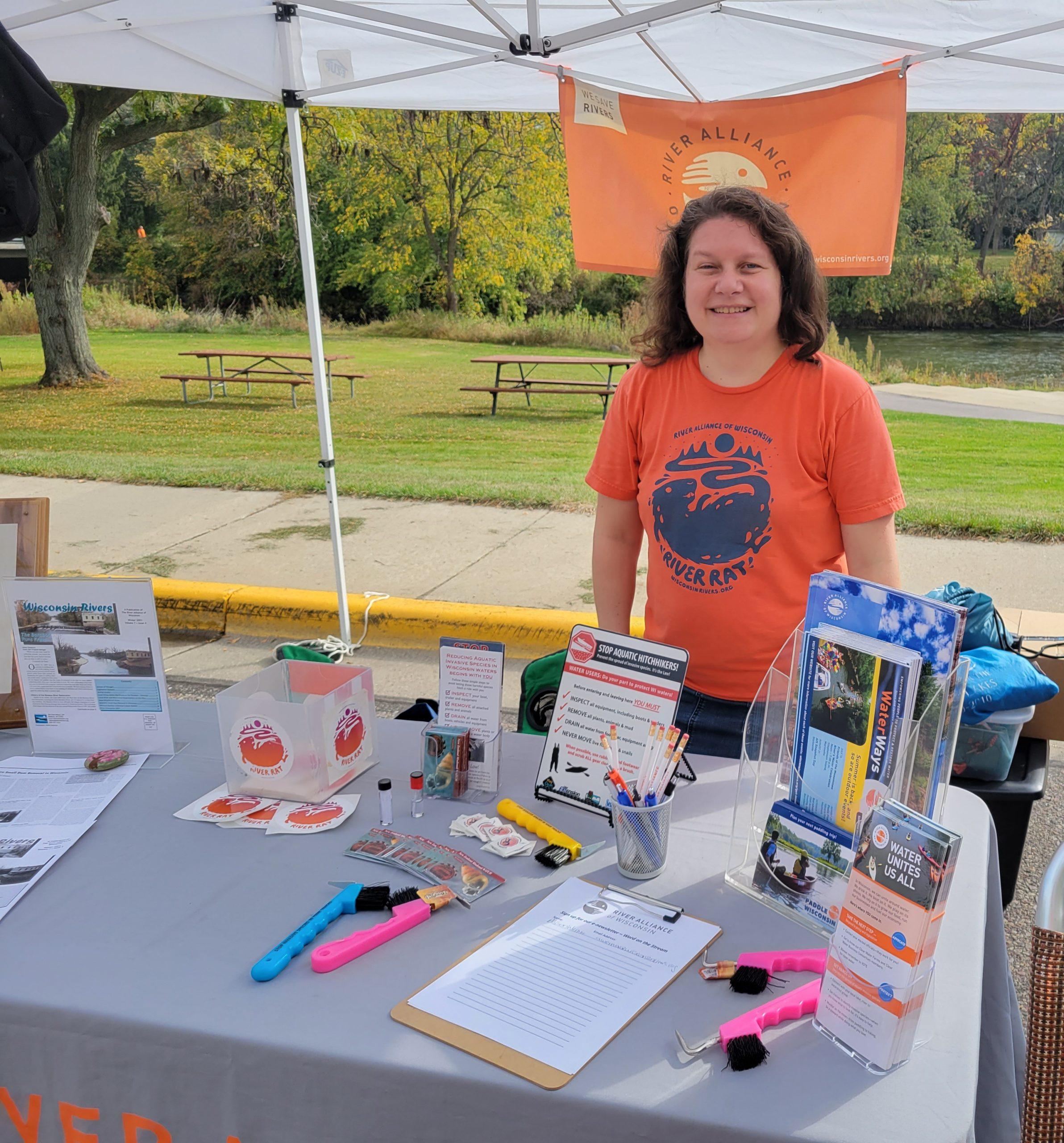 Photo of Allison Werner tabling at Baraboo River festival